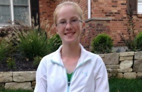 Emily Schaper (9) poses in her uniform ready for golf practice.