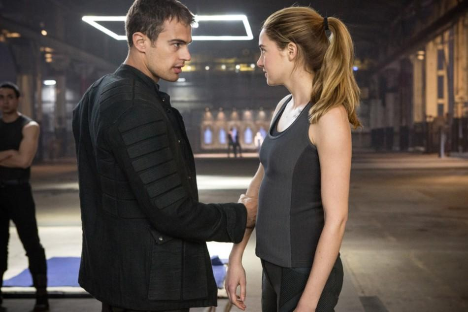 Four (Theo James) gives Tris (Shailene Woodly) a quick pep talk before fighting a fellow initiate.