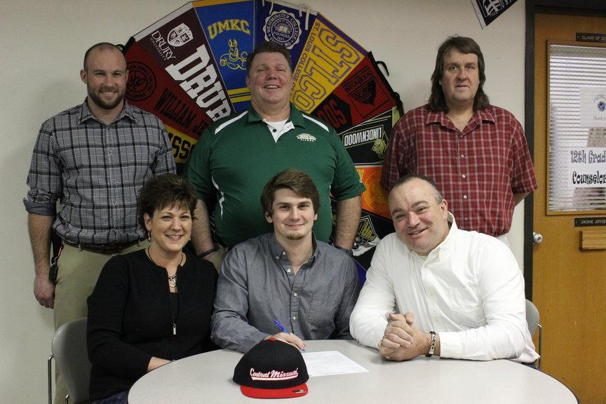 Logan Offner was surrounded by his coaches and parents when officially signing off to play football for Central Missouri State University.