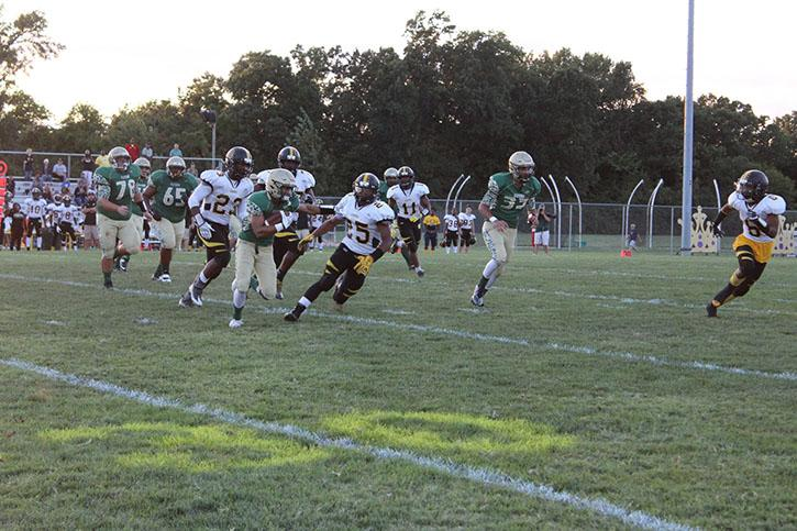 Andre Richie (12) rushing the ball against Hazelwood Central.