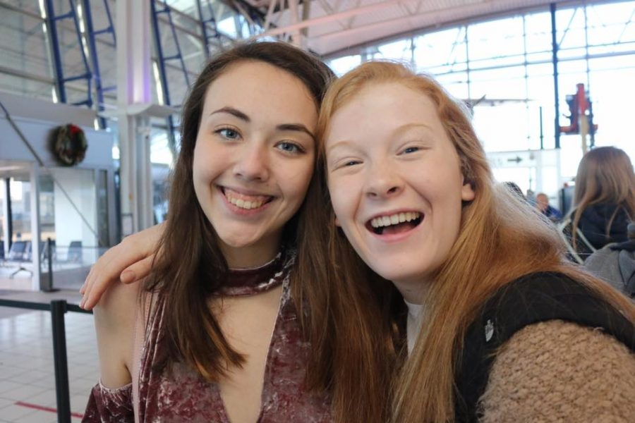 Jessica Belle Kramer (12) and Natalie Evans (11) waiting for the plane.