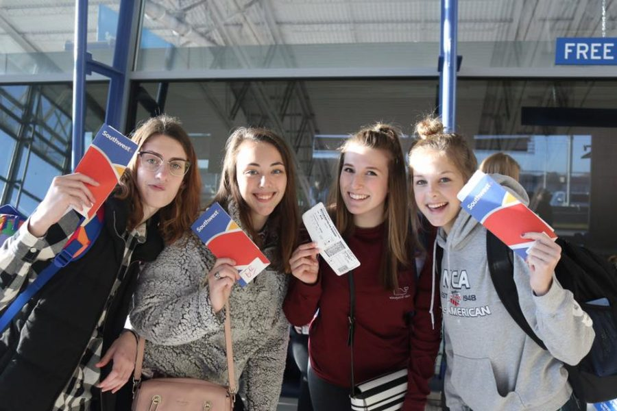 Dayle Zimmerman (10), Jessica Belle Kramer (12), Katie Meyer (11) and Savannah Gibson (10) waiting at the airport.