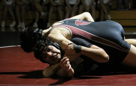 Wrestling falls to long-time rival, Rockwood Summit 42-34