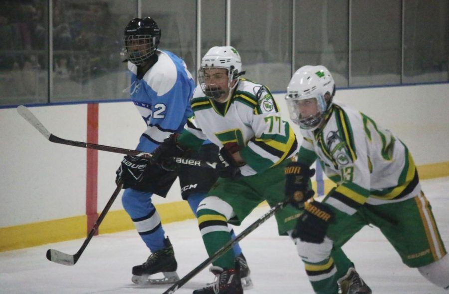 Rusty Hess (10, #77) and Jake Blessing (11, #23)