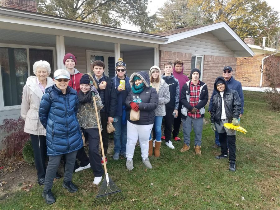 Students+from+the+academy+after+their+annual+Rake-A-Thon.+During+the+Rake-A-Thon%2C+students+went+to+senior+citizens%E2%80%99+yards+and+raked+their+leaves.+It+is+a+big+help+for+the+elderly+who+cannot+do+it+themselves+and+it+is+great+for+the+Lindbergh+community.%0A