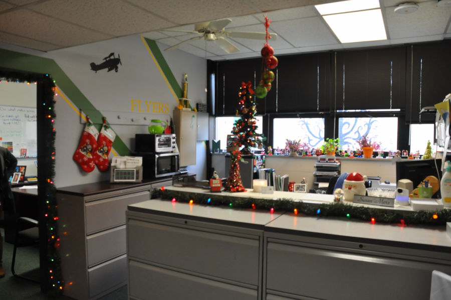 "Administrative assistant, Susan Merz shows her holiday spirit by going all out in decorating her office. Many other staff have put up decorations for the holidays in the past. ""I decorate like this at my own home and I would like to make it feel more homey and that is why we decorate and burn candles,"" Merz said."