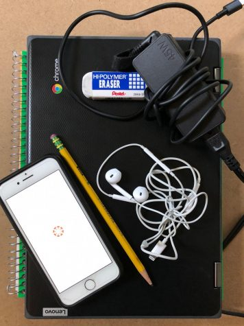 Supplies for the 2020-2021 school year rely more heavily on technology than ever before. This is a photo of one LHS student´s essentials for online learning: pencil, earbuds, charger, cell phone, eraser, notebook and school-issued Chromebook.